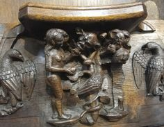 Worcester Cathedral, adam and serpent eating the fruit, Eve contemplating her fruit