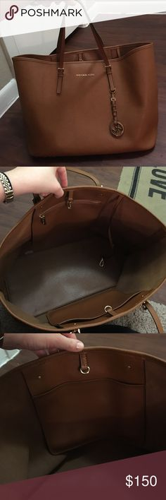 Michael Kors tote bag Camel color leather large Michael Kors tote. Fits well on shoulder. One zipper pocket and one open pocket. Interior stain from chocolate in pocket as shown in photo. Otherwise in very good condition. Michael Kors Bags Totes