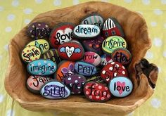 Painted stones | Stones and paint markers are great to use in expressive art session or as an termination activity. Here I am using as an termination session where my client will  can pick a word that inspires her to keep going, set it in stone.