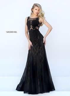 Vamp it up in lace in the Sherri Hill 50254 full-length prom dress with soft A-line silhouette. The sheer sleeveless bodice showcases a scoop neckline and is richly embellished with textured lace appliques. Lace appliques accent the illusion scoop back. The long skirt flows in soft lace folds beneath a sheer overlay.