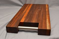 Walnut cutting / chopping / serving board with rosewood accent and stainless steel handle available in our store