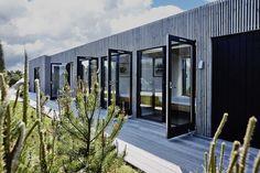 Et hus, der forholder sig til den omkringliggende natur og integrerer kvaliteterne ved simple living.