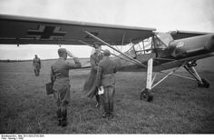 Russia, 1942: Ranking Luftwaffe officer arrives at forward airfield in a Fieseler Storch Fi 156 light observer plane. The Fi remains famous for her STOL capabilities that made her perfect platform for establishing air liaison with locations in difficult terrain. The Fieseler factory in Kassel produced an estimated 2,900 Fi 156s during the war.