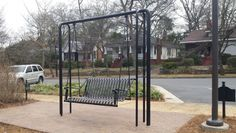 Imagine treating bus riders as well as light rail, car commuters - Prototype of the swings that will be installed along Central Avenue, part of a project to encourage a movement to make bus stops less bleak. Image courtesy Tom Warshauer, City of Charlotte
