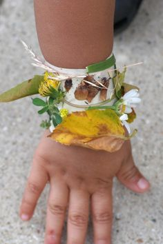 My Delicious Ambiguity: Camping Tot School Ideas  Nature Bracelet - Before taking your class on a nature walk, put a thick strip of masking take sticky side out around their wrists. As they are walking they can add whatever they find to their bracelet. When you return they can use their bracelets as inspiration for a spring time 5 senses poem... Springs looks like... Spring sounds like... Springs smells like... Etc...
