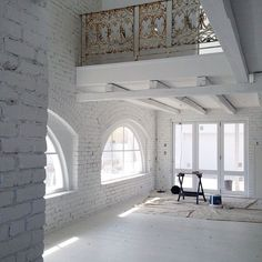 = white loft and rusted iron balustrade