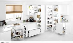 Calling all storage nerds! This is the perfect storage solution combination, with pull out larder, draws, spice rack storage, larder carousel and space saving corner pull out. Perfect way to hide all your clutter leaving your kitchen to be clean, crisp and white. Contemporary handless white gloss kitchen, grey laminate worktop with clean white floor tiles. Photography and kitchen design inspiration by http://capture.setvisions.co.uk/Portfolio