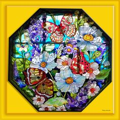 http://fineartamerica.com/featured/butterfly-octagon-stained-glass-window-thomas-woolworth.html
