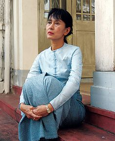 Aung San Suu Kyi, looking beautiful.  This is a woman who can protect Burma in one breath and win the Nobel Peace Prize with the next!