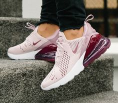 Cool Nike Air Max 270 shoes Barely Rose walking up street steps in black jeans.