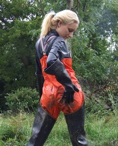 Blonde in muddy waders and overalls