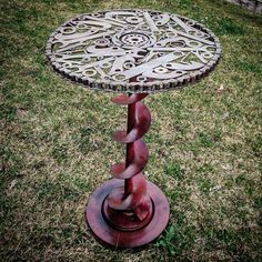 I'm working on my scrap art collection. I made this one of a kind table with all scraps I found on the ranch. I used a brake rotor for the base, an old auger shaft for the stand and for the table top I used a seized up roller chain filled with wrenches, irrigation locks, allen keys, nuts, washers, bearings, and more! What a fun project for this gal! Made custom by me, Rachel Bohnet at Country Custom Fabricating