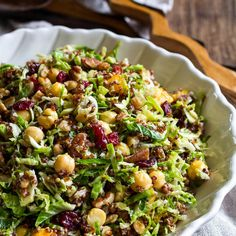 Warm Quinoa Brussels Sprouts Salad Recipe Salads, Side Dishes with winter squash, olive oil, salt, pepper, red quinoa, brussels sprouts, chickpeas, chopped walnuts, dried cranberries, dressing
