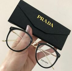 Brown acetate Prada round eyeglasses with multicolor print surface and gold-tone metal detail. Prada Glasses Frames, Glasses Frames Trendy, Fake Glasses, Glasses Style, Cute Sunglasses, Sunglasses Women, Glasses Trends, Lunette Style, Prada Eyeglasses