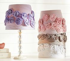 "Gathered Rose Shade - This lavish lamp shade is festooned with ruched fabric and matching roses. The soft hues complement a range of lamp bases and color schemes.  11"" diameter x 9.25"" high.  Expertly crafted of pure cotton.  Available in pink, lavender, white or gray. ($59.00)"