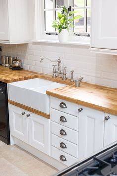 This beautiful oak kitchen from Solid Wood Kitchen Cabinets features units made entirely from solid European oak, with frontals painted in Farrow & Ball's All White. Stunning solid oak worktops complement the country design, and a classic double Belfast sink with satin nickel tap fixtures is the perfect choice. To see more inspiring kitchen designs, visit our website: www.solidwoodkitchencabinets.co.uk
