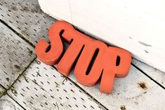 """Concrete """"STOP"""" Doorstop (this method can be used to make bookends)"""