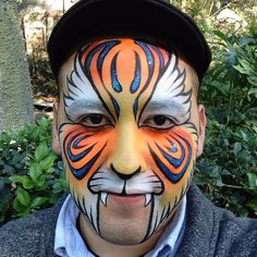 Painting faces at the LA Zoo today  #tiger #facepainting #facepaint #makeup #kryolan #sugarglitter #lazoo #bodypainting