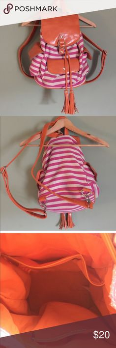 "Orange and Pink Striped Backpack Adorable and generously sized backpack-purse (not really big enough to be considered a genuine backpack.) Vegan leather orange accents. Inside is spacious and same color orange as outside. In excellent pre-loved condition; no holes, rips or tears! 13""H x 11""W approximately Bags Backpacks"