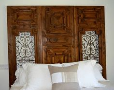 Bedroom - King headboard custom designed and built from a large exterior #French iron door.
