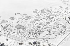 Early last year, artist Sonja Hinrichsen (previously) and some 60 volunteers wearing snowshoes trekked out onto the frozen Catamount Lake in Colorado to trample miles of swirling and twisting patterns into the deep snow. Titled Snow Drawings at Catamount Lake, the work was a continuation of her co