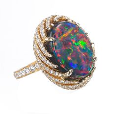 Hatta Fine Jewelry--This black opal and diamond ring is so breathtaking that it almost makes me cry! It's so impressive when you think of what can be found in nature!
