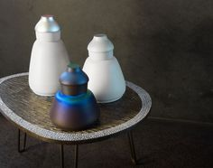 presented at maison et objet, opalescent paint has been applied to the vessels, making every angle of the product unique as it catches the light.