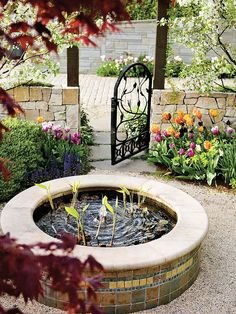 A small stand-alone pond on a patio or deck or in a garden niche can be an interesting architectural feature. A bonus: It can be a less-expensive way to start working with water plants and perhaps even a few fish. Here, the edge of the water feature is wide enough to provide seating, too.Include a Stand-Alone Pond