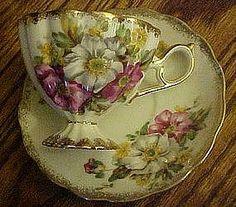 Fancy pedestal teacup and saucer set, multi florals