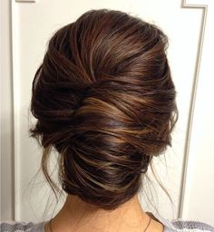 Smooth French twist updo on brown hair