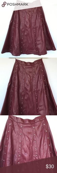 Romeo & Juliet Couture Faux Leather Skirt Romeo & Juliet Coture Faux Leather Skirt with studs. Beautiful burgundy color. Studs going down front of skirt. Hidden back zipper. Lined. Skirt measures 25in in length. Romeo & Juliet Couture Skirts A-Line or Full