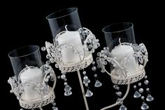 Stunning 3 arm candelabra for hire from Sprinkle of Magic Wedding Planners.  Cream in colour with stunning and beautiful droplets. Look amazing on your table as centrepiece.