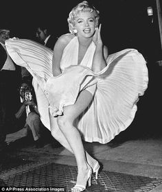 Iconic: Marilyn's skirt blows up as a train passes under the subway grate in 1955