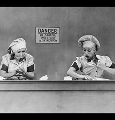 Trading places: After the boys attempt to do housework, Lucy and Ethel try to earn a living at the chocolate factory. (Photo courtesy CBS Photo Archive/Getty Images) - I Love Lucy Picture #styleicon #modcloth