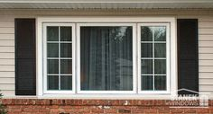 White casement windows with interior colonial grids flank a picture window. #windows #homeimprovement