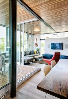 Floor-to-ceiling windows in the main living space overlook Lake Union.