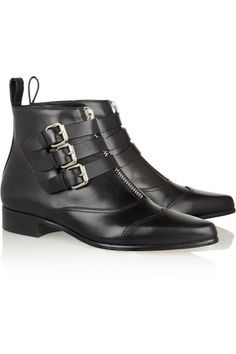 love the contrast between the elegant pointed toe and utilitarian buckled straps.
