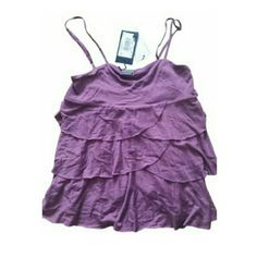NWT ARMANI EX PURPLE TIERED TANK $98 XS New $98 Armani tiered adjustable spaghetti straps top. Purple. Super soft. Authentication card and serial number attached. Armani Exchange Tops Tank Tops