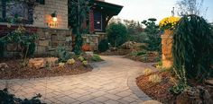 A walkway can be designed to add atmosphere and shape while providing a clear path to visitors protecting your lawn. A walkway or path featuring a thoughtfully designed mix of paver laying patterns creates visual interest, leading the way while captivating the senses.