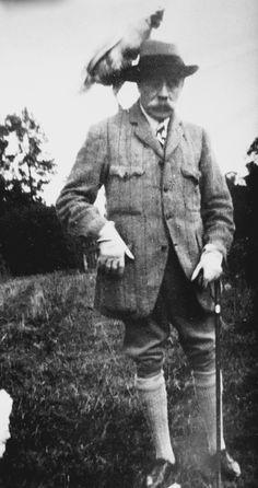 Sir Edward Elgar looking dapper with a chicken on his head.