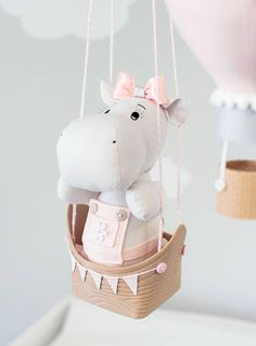 Hot air balloon baby mobile, hippo travel theme nursery decor. Pink and Gray baby girl nursery decoration. A baby hippo sits in a tiny boat floating along on great adventures. She is surrounded by 4 little hot air balloons, decorated with various pompoms, lace, bunting flags, bows