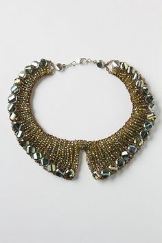 This collar necklace gives the impression of an embellished peter pan collar when worn with the right dress or top.