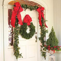 101 Fresh Christmas Decorating Ideas | Add Color to Your Front Door | SouthernLiving.com