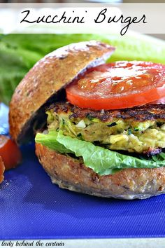 Zucchini Burgers. 2 cups zucchini,  1 medium onion,  1/2 cup dry bread crumbs,  2 eggs,   1/2 teaspoon salt,  dash of cayenne pepper,  3 hard cooked egg whites,  2 tablespoons oil,  4 whole wheat hamburger bunt,  toppings (lettuce, tomato and onion) sub almond meal