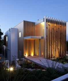 Bossley Architects have designed the Brown Vujcich House in Auckland, New Zealand.