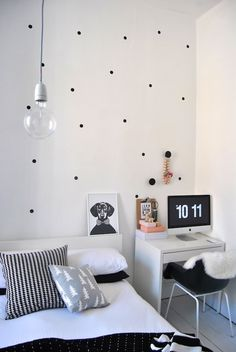 white and black bedroom with office desk.  love the black poka dots on the wall