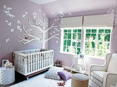Purple white and grey (could do a pretty pastel green and add either blue or pink when the baby arrives)
