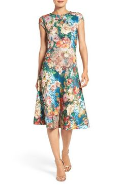 ECI Floral Scuba Fit & Flare Midi Dress at Nordstrom.com. A sprawling, vibrant floral print blooms wildly across a flattering fit-and-flare dress cut in a midi length from trend-right stretchy scuba for a silhouette-enhancing fit. A jewel neck and cap sleeves complete the look with feminine elegance.