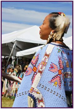 Lady with magnificent embroidered dance regalia at Post Falls Julyamsh powwow, Idaho, 2013. Bead-embroidered, mainly lane stitch.