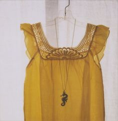 lovely top and seahorse necklace (although I would want a different color....I know mustard is all the rage but not for me)